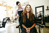 Hairdresser and customer in hair salon - BLEF05390