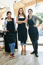 Smiling hairdressers posing in hair salon - BLEF05396