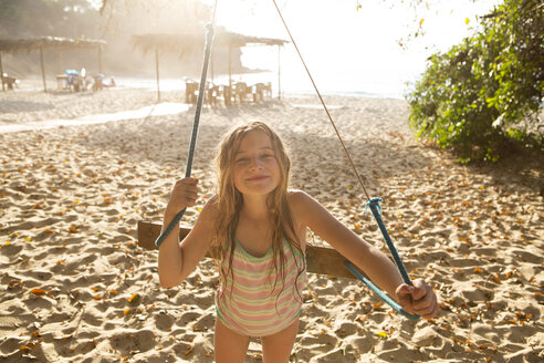 Caucasian girl playing on tree swing - BLEF05513