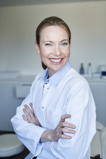 Portrait of smiling female doctor in medical practice - PNEF01510