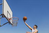 Young man playing basketball - MGIF00493