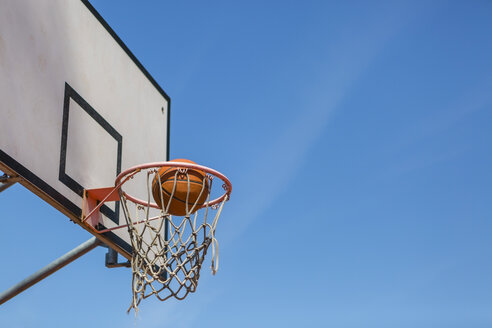Basketball and hoop, blue sky - MGIF00520