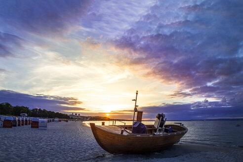 Boat on the beach at twilight, Binz, Ruegen, Germany - PUF01517
