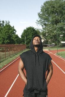 Portrait of sportsman wearing black hoodie shirt - AHSF00431