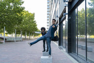 Portrait of two playful businessmen in the city, Barcelona, Spain - AFVF03096