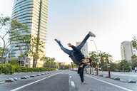 Man making a handstand on the street in the city, Barcelona, Spain - AFVF03162
