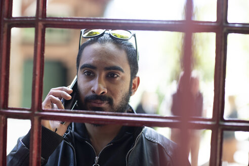 Portrait of bearded young man on the phone - SGF02373