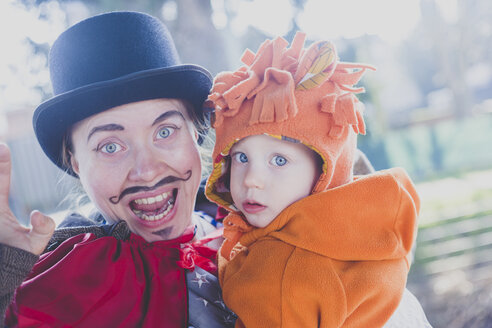 Portrait of mother and little son dressed up for carnival - IHF00083