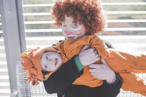 A man dressed as a clown and a little boy dressed as a lion baby going to the carnival, Germany, Düsseldorf - IHF00086