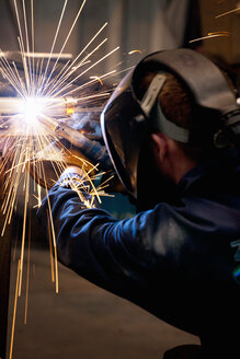 Close up of welder using welding saw - JUIF01053
