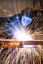 Welder using welding saw - JUIF01098