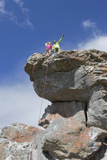Rock climbers on top of rock - JUIF01110