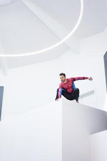 Businessman dressed up as superhero in office - MOEF02240