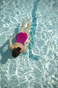 High angle view of Caucasian woman swimming in pool - BLEF06083