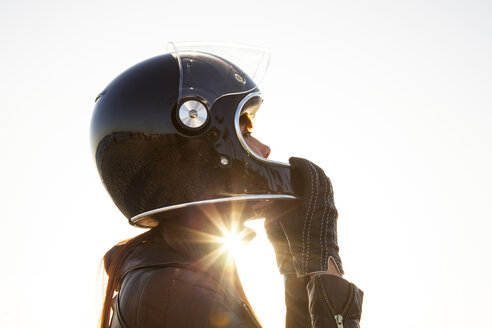 Caucasian woman wearing motorcycle helmet - BLEF06621