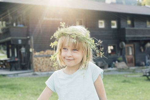Little girl wearing flowers in her hair, Jochberg, Austria - PSIF00276