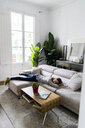Young woman lying on the couch at home - GIOF06483