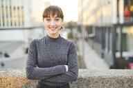 Portrait of smiling young woman with arms crossed - PNEF01571