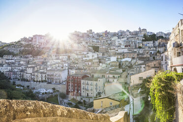 View from Ragusa Ibla to Ragusa Superiore in backlight, Ragusa, Sicily, Italy - MAMF00755