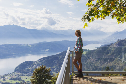 Woman standing on observation point above Millstatt Lake, Carinthia, Austria - GWF06078