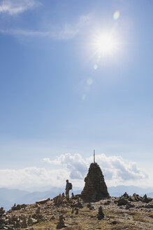 Hiker at viewpoint with cairn, Lammersdorf Mountain, Nock Mountains, Carinthia, Austria - GWF06087