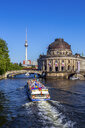 View to Bode Museum and Berlin TV Tower with tourboat on Spree River in the foreground, Berlin, Germany - PU01625