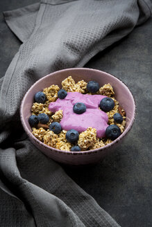 Bowl of Granola with almonds, blueberries and bluebery yoghurt - LVF08072