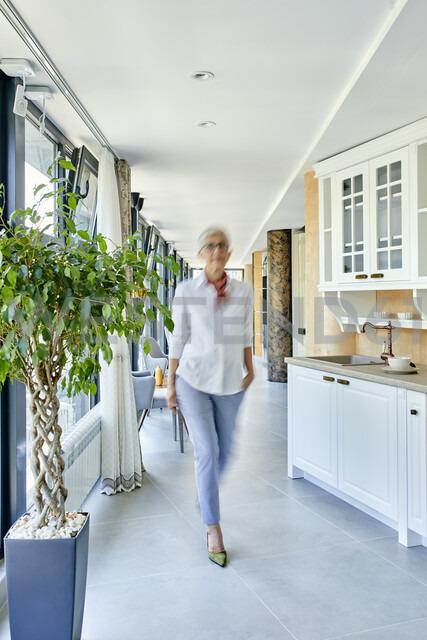 Serbia, Novi Sad, Furniture showroom, Motion blur, Senior woman - ZEDF02298