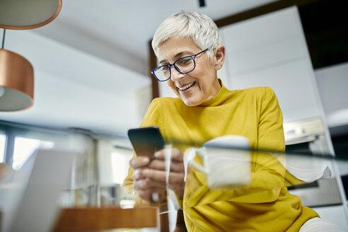 Serbia, Novi Sad, Senior Woman, Smartphone, Coffee - ZEDF02406