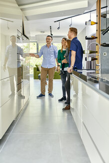 Family shopping for a new kitchen in showroom - ZEDF02455
