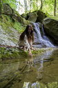 Young woman at a natural pool in forest, Garrotxa, Spain - AFVF03258