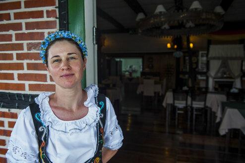 Traditional dressed woman in the German speaking town of Pomerode near Blumenau, Brazil - RUNF02419