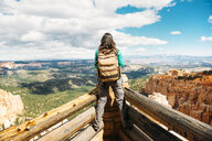 Women hiker with backpack on a lookout in Bryce Canyon, Utah, USA - GEMF02974