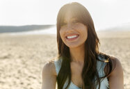 Portrait of a smiling young woman on the beach - MGOF04100