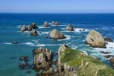 View from the Nugget Point Lighthouse in the turquoise waters with huge rocks, The Catlins, South Island, New Zealand - RUNF02579