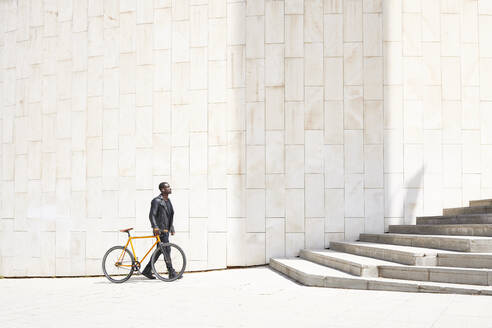Man with bike - JND00073