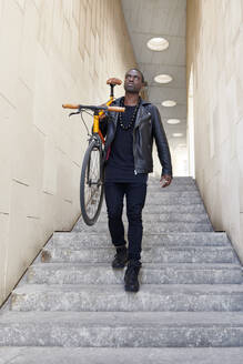 Man carrying his bike - JND00079