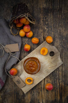 Apricot jam and apricots on dark wood - LVF08082