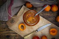 Apricot jam and apricots on dark wood - LVF08085