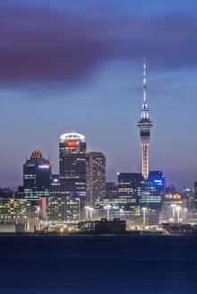Auckland skyline lit up at night, New Zealand - MINF11596