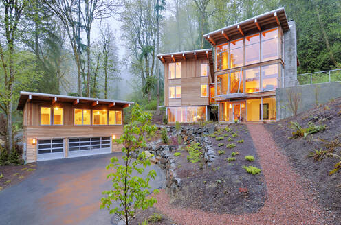 Modern house illuminated in woods - MINF11677