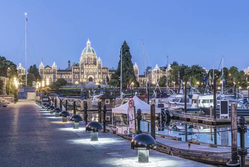 Parliament Buildings and harbor illuminated at dawn, Victoria, British Columbia, Canada - MINF11758