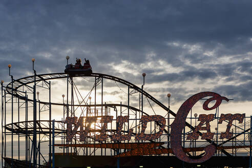 Silhouette of wild cat rollercoaster at Puyallup Fair, Puyallup, Washington, United States - MINF11899