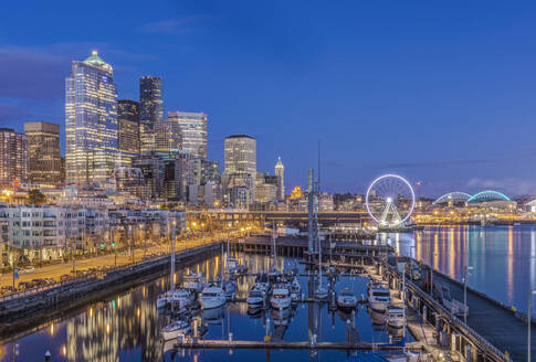 City skyline lit up at night, Seattle, Washington, United States - MINF11983