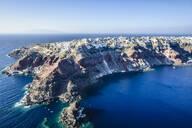 Aerial view of city built on rocky coastline, Oia, Egeo, Greece - MINF12031