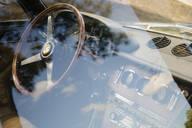 Vintage Ferrari dashboard viewed through window - MINF12043