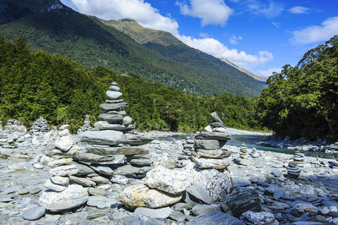 Man made stone pyramids at the Blue Pools, Haast Pass, South Island, New Zealand - RUNF02620