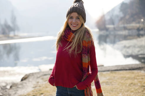 Young blond woman at a lake in winter - JSRF00204