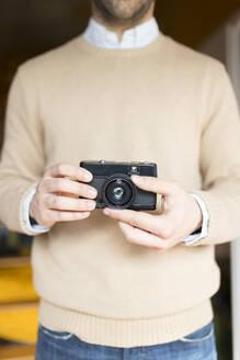 Man holding camera - JPTF00156