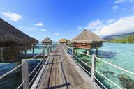 Decks connecting bungalows over tropical ocean, Bora Bora, French Polynesia - MINF12231